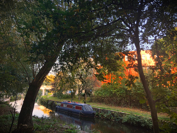 A picture of the canal next to the university of huddersfield with a canal barge on it