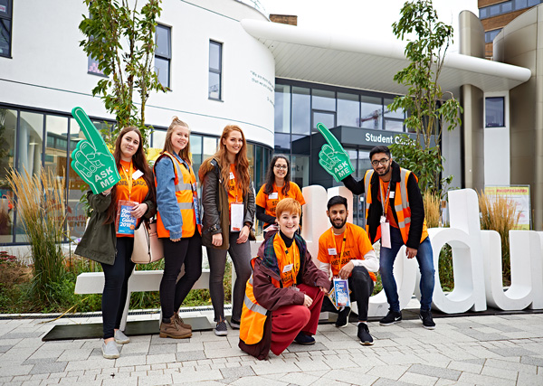 A group photo of seven student ambassadors posing with